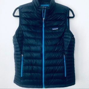 Patagonia Woman's Down Sweater Vest. Navy Blue